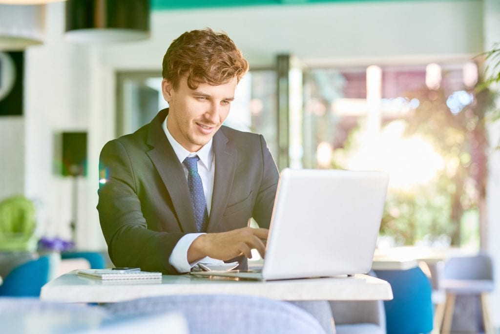 Elegant Businessman Working with Laptop